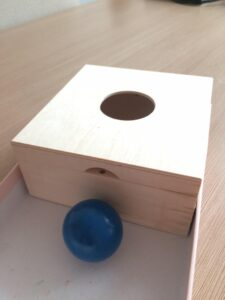 81. Box with a ball